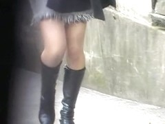 Open-minded pretty babe is walking on the street during fast sharking attack