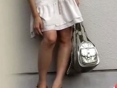 Asian babe waiting for friends gets a skirt sharking.