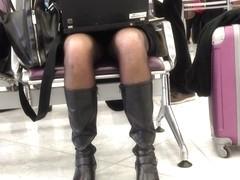blond business woman upskirt at airport