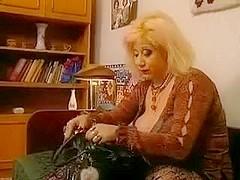 Slutty Granny Zhanna in stockings rewards voyeur with a fuck