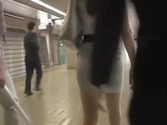 Candid upskirt of the young beauty in strict office dress