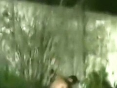 Voyeur tapes a latin couple having sex in the bushes