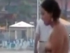 Dirty friendwn skin girl rides her partner in public beach