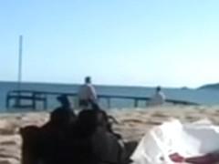 Shameless German couple has torrid sex on the beach