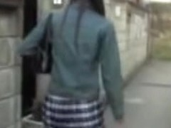Long-haired slender gal flashes her ass during quick sharking affair