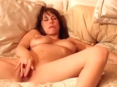 Playing with her vagina and doing his cock simultaneously