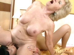 Horny blonde woman enjoys licking this sexy brunette's juicy twat