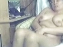 Watch my mature mom home alone fingering pussy. Hidden cam