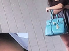 Babe in mini skirt walks around the upskirt voyeur