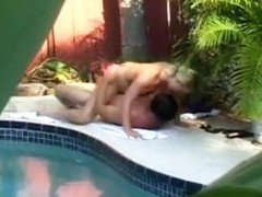 Voyeur tapes the neighbors having sex next to the swimming pool