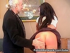 Ass spanking for a naughty brunette schoolgirl
