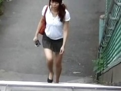 Smiley long-legged amorous vixen flashes her twat during sharking attack