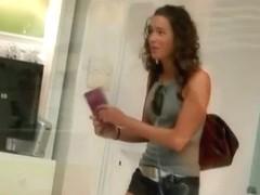 Hot brunette in a street candid video
