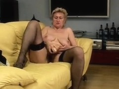 granny masturbating on bed