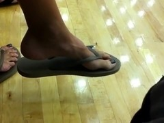 MILF dangling flip flops at the gym
