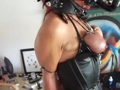 Redhead slave girl in leather being caned hard