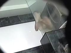 Full bodied female voyeured showering on the spy cam