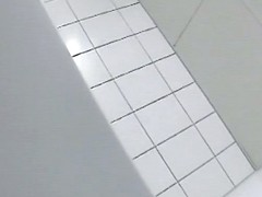 A blonde is pissing in the college toilet