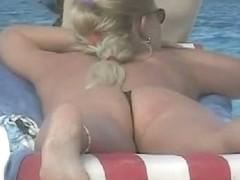 A randy voyeur using his hidden cam to film girls on a nude beach.