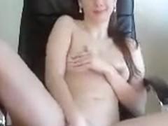 Feminin masturbates in a leather chair