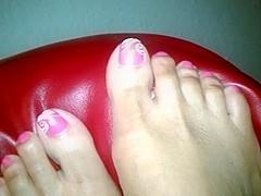 Light skinned ebony feet on couch