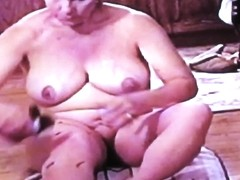 Mature Nude Woman Applying Sunless Tan Lotion