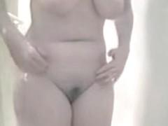 Curvy girl having a shower