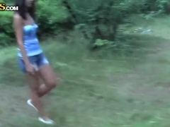 Leggy Olympia shows off her bottoms before giving blowjob around the bushes