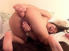 Naughty Asian squirts her pussy live