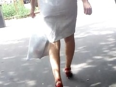 Blond walking in the street, white dress, red heels