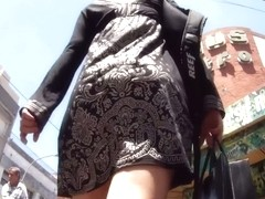 Fair haired chick in a nicely designed black dress upskirt porno