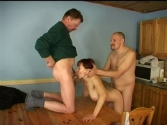 Redhead screwed by two studs