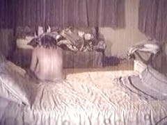 Voyeur tapes a girl watching herself masturbates in a mirror on her bed