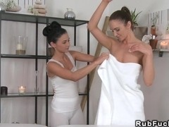 Sexy brunette lesbians getting a massage with oil
