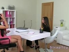 Brunette lesbians having strap on fun on casting