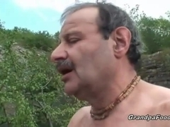 Superb babe rides grandpa's cock in nature