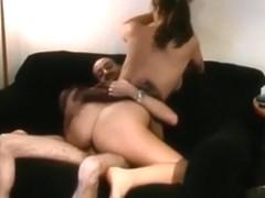 Ponytailed brunette fucks her bf on the sofa