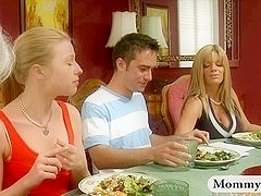 Mature stepmom jacks off teen boy under the table at dinner