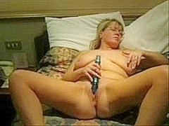 mature blonde chick masturbating with dildo