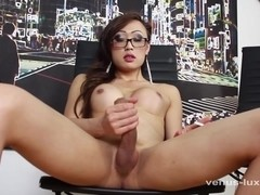 Hot Asian Shemale Jerks Off Watching Porn