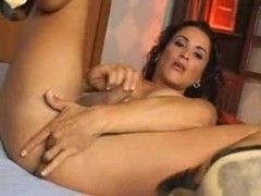 A lot of sperm on Tgirls face and boobs