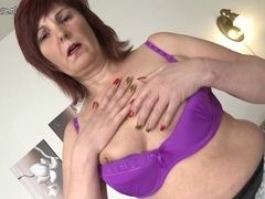 Hot grandmother plays with her beloved toys