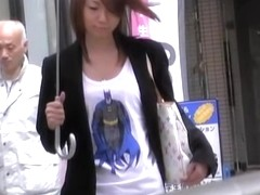 Asian babe in a short skirt gets a street sharking.