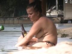 Nude beach voyeur camera shot of sexy well endowed people