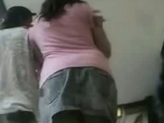 Her awesome jeans skirt is beingh filmed very closely