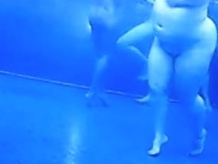 Voyeur cam vid of a bunch of naked people in pool
