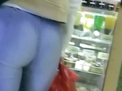 Non-nude street voyeur video of a terrific ass going shopping