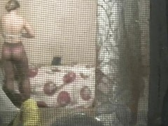 Spying through the window teen dressing