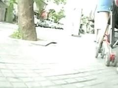 Enticing bum in an upskirt voyeur video