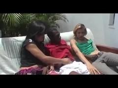 Outdoor interracial threesome sex